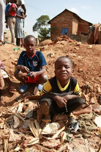 Kids play in waste