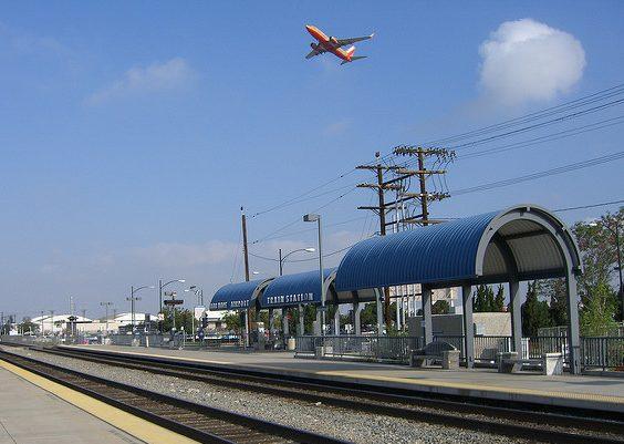 Plane flies over rail tracks