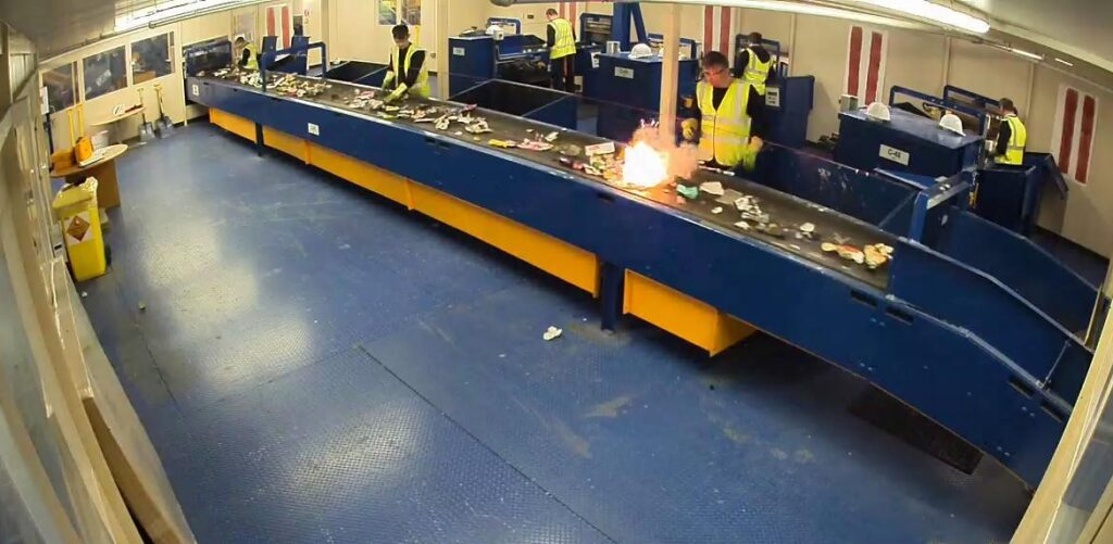 A Li-ion battery 'going off' on a MRF sorting line.